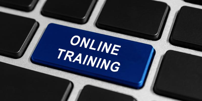 blue online training button on keyboard