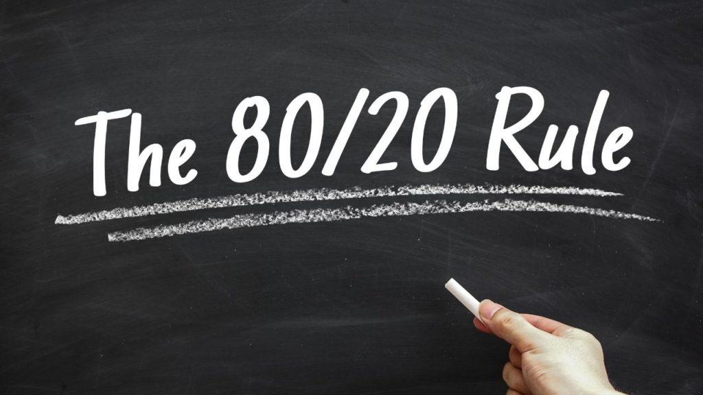 80 20 rule is written in chalk on a board